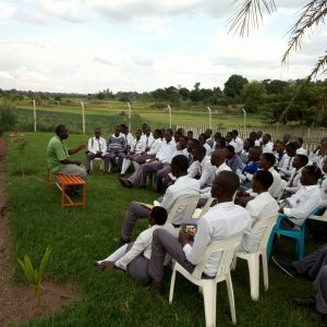 Dauson preaching the gospel at Busoga Farms
