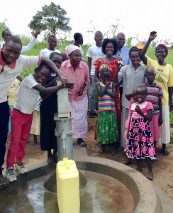 African women and children at a flowing well